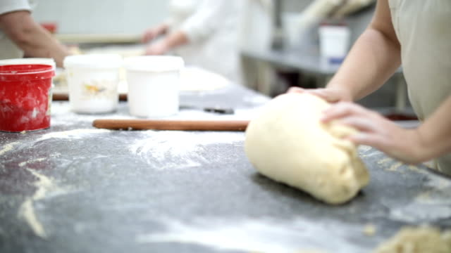 hardworking woman baking - kneading stock videos and b-roll footage