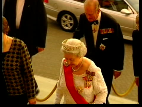 hardy amies death announced lib queen elizabeth ii wearing a dress designed by sir hardy amies prince philip and others arriving at building pull - dress stock videos & royalty-free footage