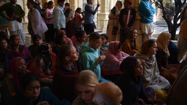 hare krishna playing kirtan chants, vrindavan, india. - narrating stock videos & royalty-free footage