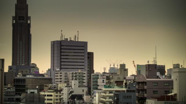 harijuku haze - timelapse - 夕暮れ点の映像素材/bロール
