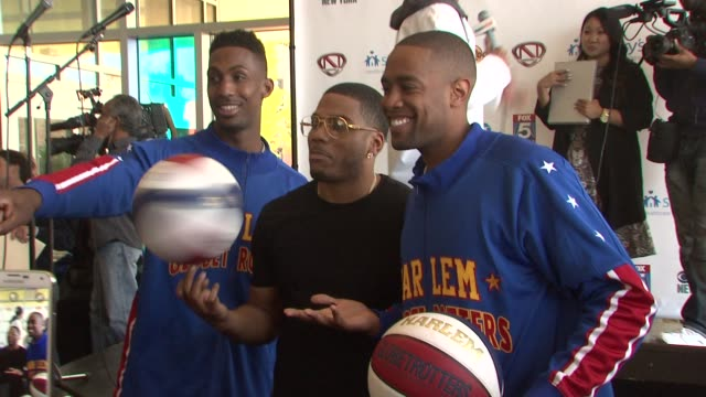 harlem globetrotters and nelly at nick cannon rocks lights empire state building for st. mary's kids at the empire state building on october 15, 2015... - ハーレムグローブトロッターズ点の映像素材/bロール