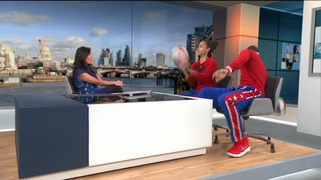 harlem globetrotters come to london; hoops green and zeus mcclurkin live studio interview as performing tricks sot - ハーレムグローブトロッターズ点の映像素材/bロール