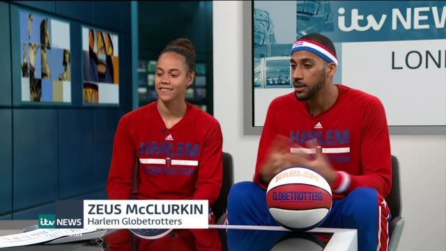 harlem globetrotters come to london; hoops green and zeus mcclurkin live studio interview sot - ハーレムグローブトロッターズ点の映像素材/bロール