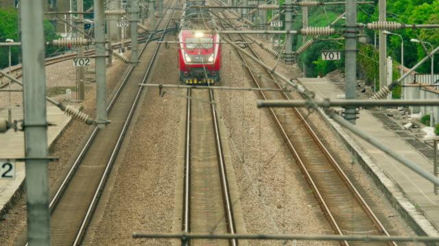 harmony high-speed train  (hexie in chinese) approach shanghai station - railway track点の映像素材/bロール