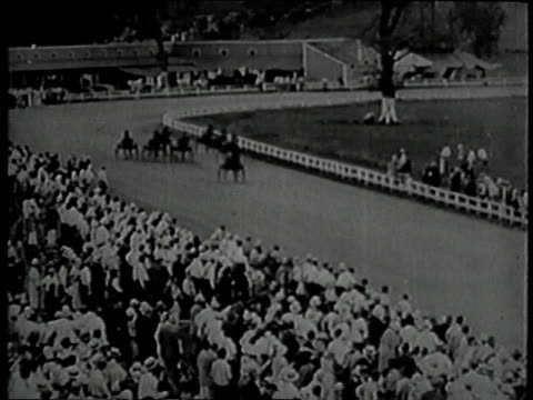 harness race / crowd watching the harness race / lord jim in the winner's circle - 1934 bildbanksvideor och videomaterial från bakom kulisserna
