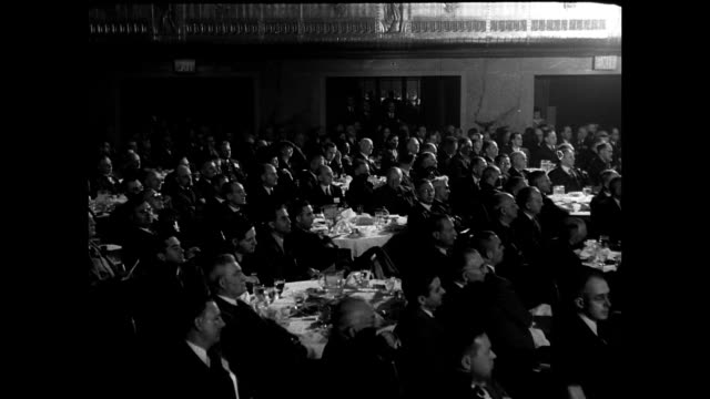 stockvideo's en b-roll-footage met headline 'harnessed atom could make life easier' atomic energy symposium panel sitting on stage w/ audience at tables vs audience scientists... - 1946