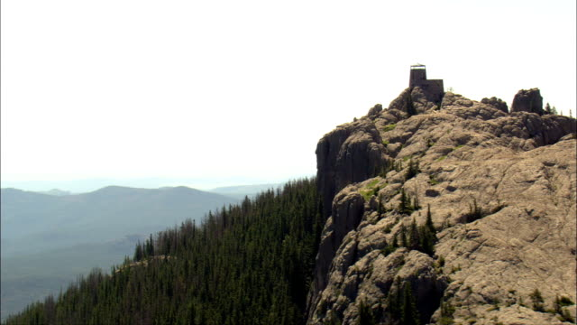 harney peak and look out tower  - aerial view - south dakota,  pennington county,  united states - peak tower stock videos and b-roll footage