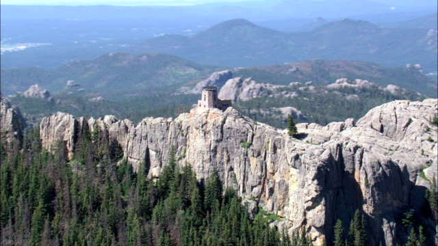 harney peak and look out tower  - aerial view - south dakota,  pennington county,  united states - mountain peak stock videos & royalty-free footage
