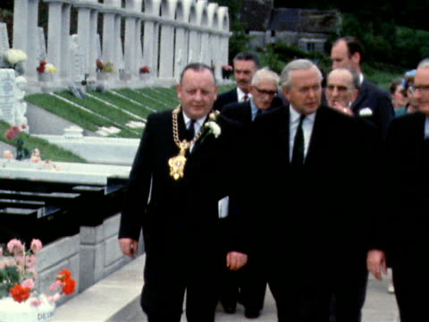 harold and mary wilson and an official party walk through the memorial garden to the victims of the aberfan coal tip disaster june 1969 - harold wilson stock-videos und b-roll-filmmaterial