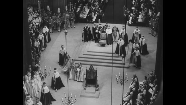 harold bradfield michael ramsey flanking the queen sitting on the throne / peeresses standing / overhead shot the queen leaves for st edwardõs chapel... - coronation stock videos and b-roll footage