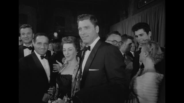 harold hecht and his wife, gloria buzzell hecht, with film partner, actor burt lancaster / man with film camera to his eye - パンテージスシアター点の映像素材/bロール