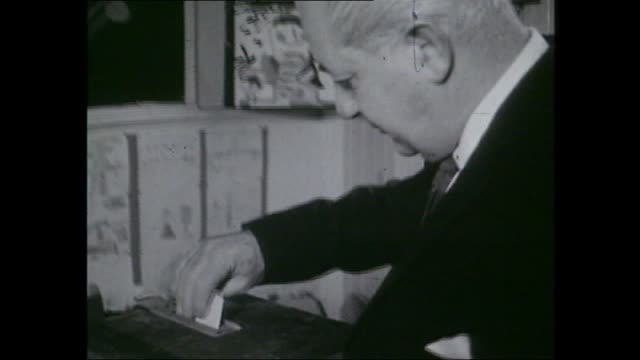 1966 election campaign / MUTE – Opposition leader Arthur Calwell voting / Prime Minister Harold Holt voting / ATN 7 camera at 1966 election tally...