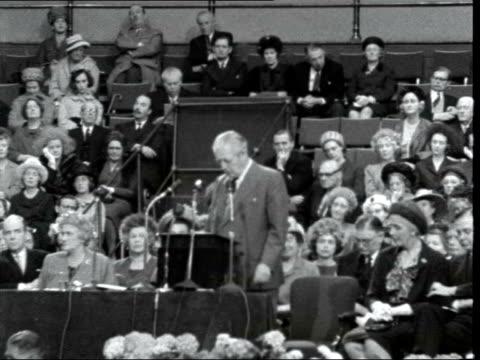 harold macmillan addresses conservative women's conference; england: london: royal albert hall: int harold macmillan mp entering amid applause harold... - royal albert hall stock videos & royalty-free footage