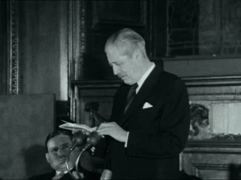 harold macmillan attends reception for bible anniversary; england: london: stationers' hall: harold macmillan mp and dr fisher shake hands macmillan... - bible stock videos & royalty-free footage