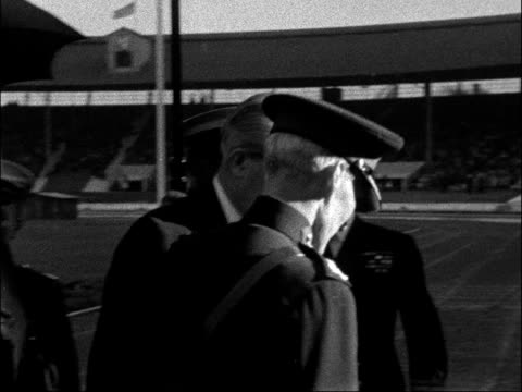 harold macmillan attends searchlight tattoo england london white city ext harold macmillan mp and wife dorothy macmillan stepping from car and along... - body adornment stock videos and b-roll footage