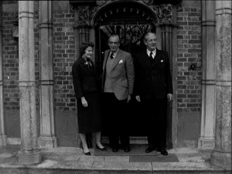 Harold Macmillan lunches with the Edens ENGLAND Newbury Donnington Grove Ext part of house LV Harold Macmillan out of house with Sir Anthony Eden and...