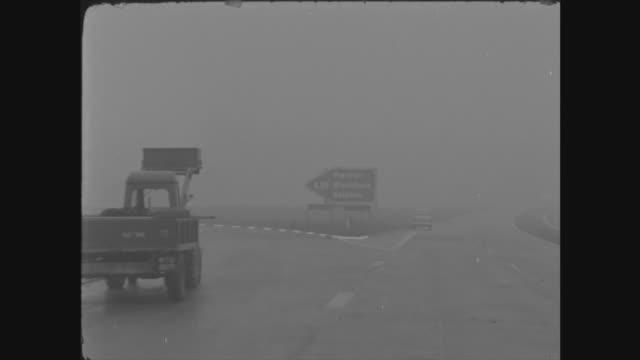 harold macmillan opens preston motorway; england: lancashire: preston by-pass: ext gv new motorway sign 'lancaster: blackburn: skipton:' pan to road... - skipton stock videos & royalty-free footage