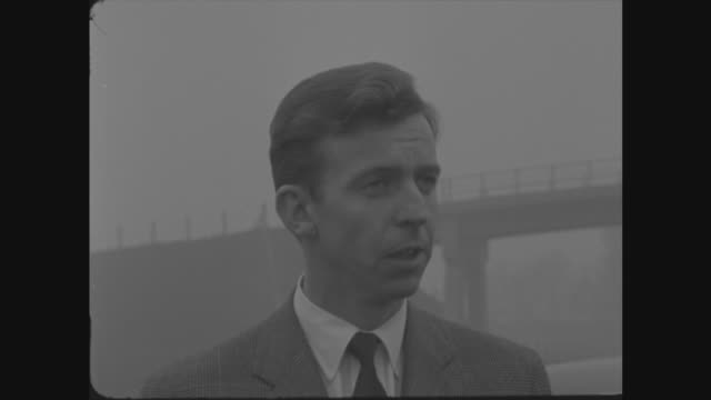 harold macmillan opens preston motorway england lancashire preston bypass tony brooks and neville clarke in car they get out tony brooks interview sof - motorway stock videos & royalty-free footage