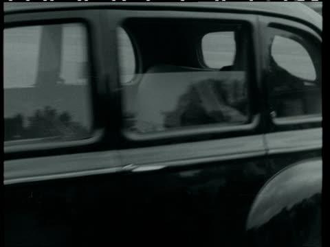 harold macmillan's new cabinet meets:; england: london: buckingham palace: mr derick heathcoat amory along to bv - in car selwyn lloyd in car along... - alec douglas home video stock e b–roll