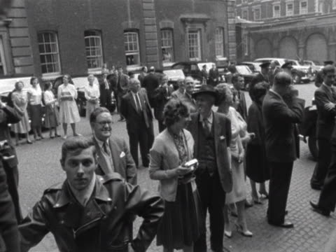 stockvideo's en b-roll-footage met harold macmilllan and his wife wave goodbye to president kennedy and jacqueline kennedy as they leave admiralty house - jacqueline kennedy