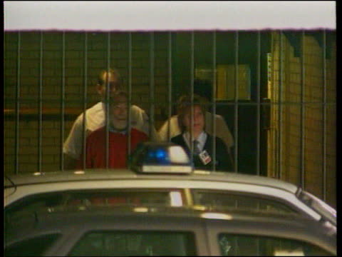 harold shipman murder trial: shipman gives evidence; c)c5l: u'lay itn england: preston crown court: ext seen thru bars dr harold shipman & prison... - crime or recreational drug or prison or legal trial stock-videos und b-roll-filmmaterial