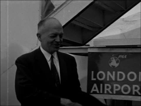 Harold Stassen arriving at London Airport ENGLAND London London Airport EXT Harold Stassen down plane steps taking his hat off then shaking hands...