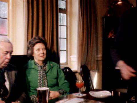 vídeos de stock, filmes e b-roll de harold wilson's last day as prime minister england bucks chequers ms harold wilson puts lead on dog mrs wilson beside him as all walk to local pub cs... - primeiro ministro