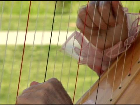 harp player - harp stock videos & royalty-free footage