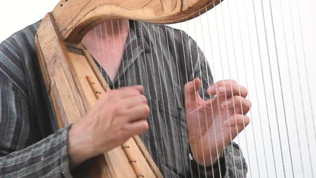 harp playing - harp stock videos & royalty-free footage