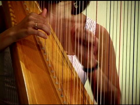 harpist - harp stock videos & royalty-free footage