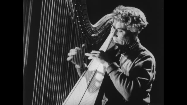 harpo marx plays the harp - plucking an instrument stock videos and b-roll footage