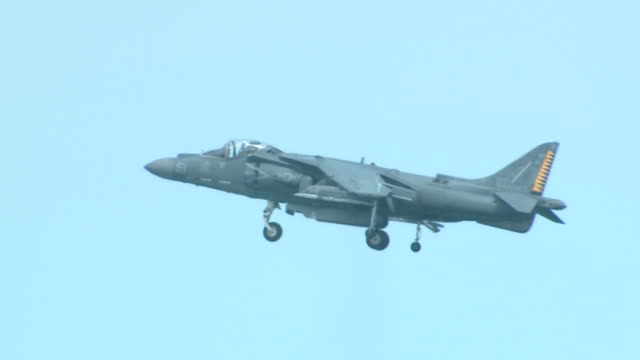 harrier ii short takeoff, vertical landing jet aircraft hovers above lake michigan during the chicago air and water show on aug. 20, 2017. - chicago air and water show stock videos & royalty-free footage