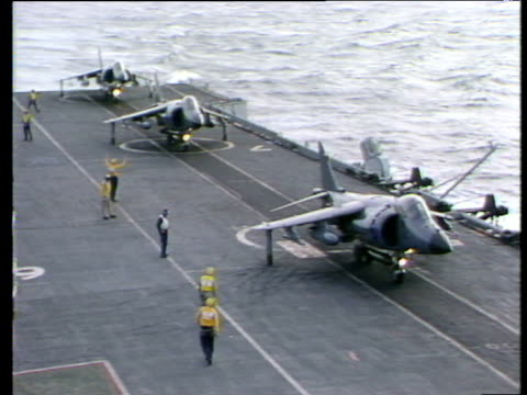 vidéos et rushes de harrier jump jets line up on deck of hms hermes for takeoff while travelling to falkland islands following invasion by argentina south atlantic 17... - 1982