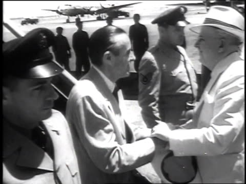 harriman disembarking plane / harriman greeted by ambassador grady / harriman arriving at shah's palace - 1951 stock videos & royalty-free footage