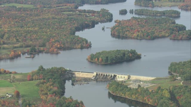 aerial harris station dam, the reservoir, scattered small islands along the kennebec river, and some autumn foliage / maine, united states - kennebec river stock videos & royalty-free footage