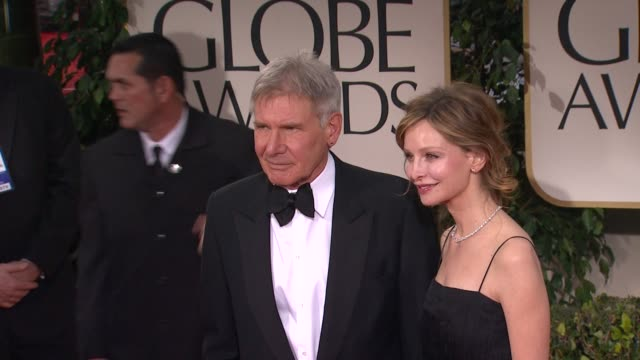 harrison ford and calista flockhart at 69th annual golden globe awards - arrivals on january 15, 2012 in beverly hills, california - calista flockhart stock-videos und b-roll-filmmaterial