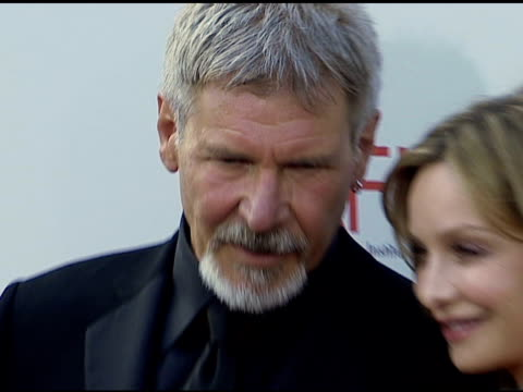harrison ford and calista flockhart at the 34th afi life achievement award: a tribute to sean connery at the kodak theatre in hollywood, california... - calista flockhart stock-videos und b-roll-filmmaterial