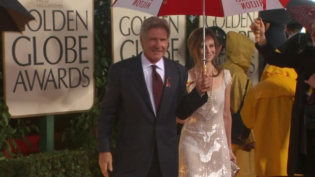 harrison ford and calista flockhart at the 67th annual golden globe awards arrivals part 5 at beverly hills ca - ゴールデングローブ賞点の映像素材/bロール