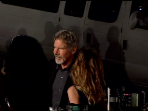 harrison ford and calista flockhart at the 'firewall' premiere on february 2, 2006. - calista flockhart stock-videos und b-roll-filmmaterial