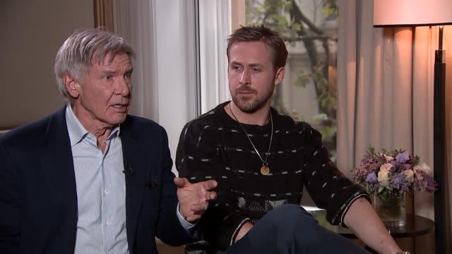harrison ford and ryan gosling interview; actors harrison ford and ryan gosling interview sot - ryan gosling on pinching himself doing 'blade runner' - pinching stock videos & royalty-free footage