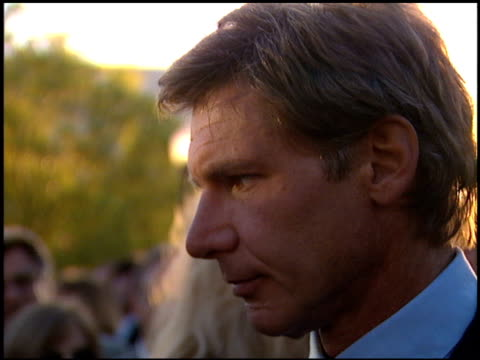 harrison ford at the 'clear and present danger' premiere at paramount theater in hollywood california on august 3 1994 - 1994 stock-videos und b-roll-filmmaterial