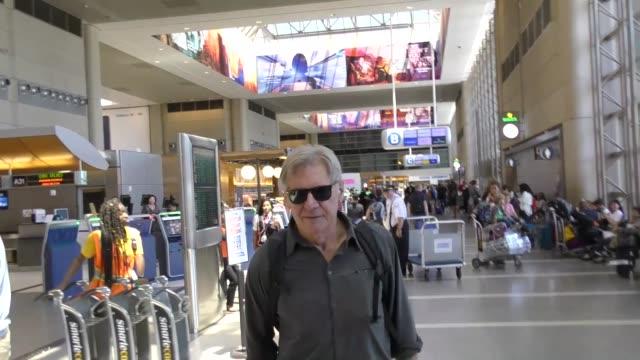 vídeos y material grabado en eventos de stock de harrison ford calista flockhart arriving at lax airport in los angeles in celebrity sightings in los angeles - calista flockhart