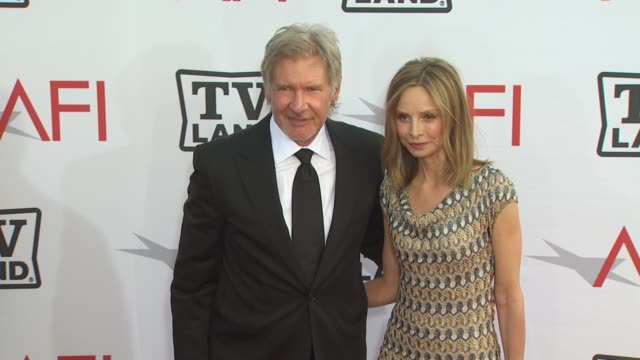 harrison ford, calista flockhart at the 38th afi life achievement award honoring mike nichols at culver city ca. - calista flockhart stock-videos und b-roll-filmmaterial