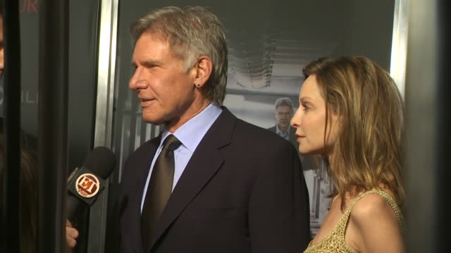 harrison ford, calista flockhart at the 'extraordinary measures' premiere at hollywood ca. - calista flockhart stock-videos und b-roll-filmmaterial