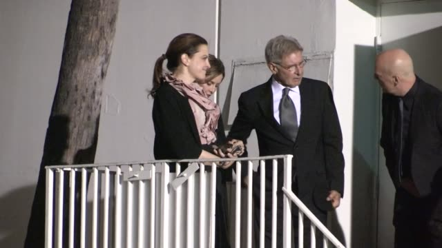 harrison ford & calista flockhart depart the 17th annual hollywood film awards in beverly hills - celebrity sightings in los angeles, ca on 10/21/13 - calista flockhart stock-videos und b-roll-filmmaterial