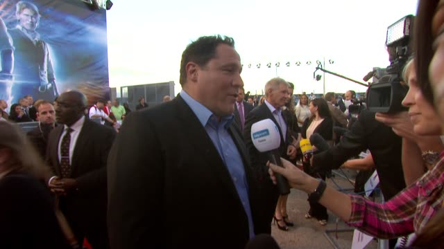 harrison ford jon favreau at the cowboys aliens uk premiere at london england - cowboys & aliens stock videos and b-roll footage