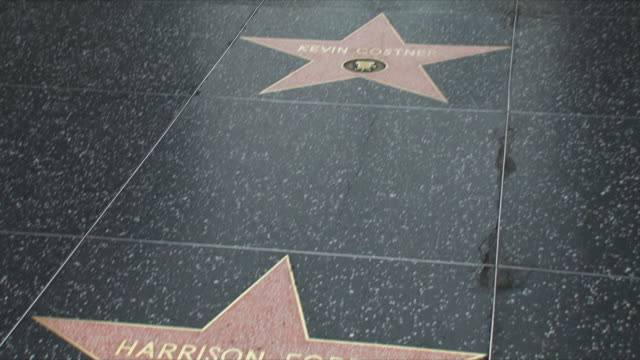 cu tu ws harrison ford's star and hollywood boulevard / los angeles, california, usa - ウォークオブフェーム点の映像素材/bロール