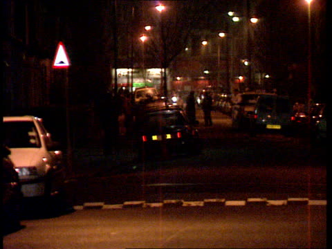 Two men held ENGLAND London BV Line of police cars with lights flashing away ZOOM IN as terrorist suspects transported to high security establishment...