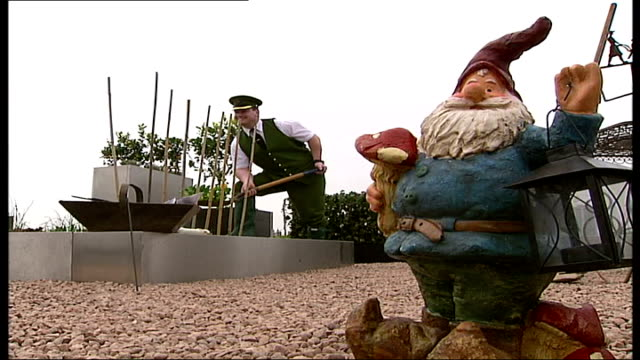 Harrods department store unveils roof top allotment ENGLAND London EXT Ramshackle shed on allotment as reporter to camera GRAPHIC EFFECT to Harrods'...