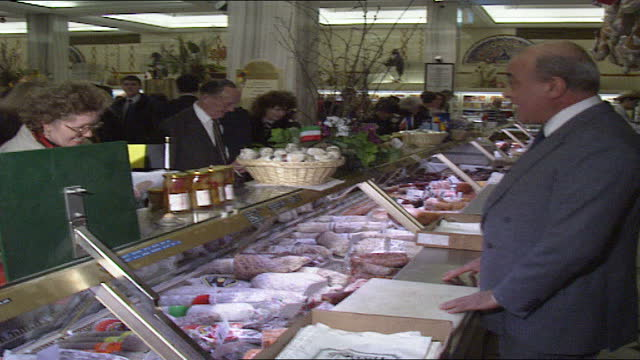 takeover report verdict; england: london: knightsbridge: harrods: int harrods owner mohamed al-fayed along through food hall chatting customers and... - slice stock videos & royalty-free footage
